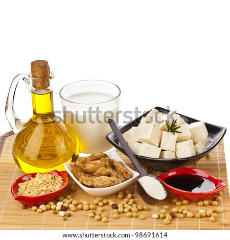 Soy products : oil,  milk, tofu, meat beef stroganoff, sauce, in wooden table isolated on white background - stock photo