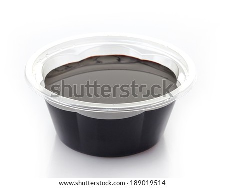 Soy sauce in a plastic take away container - stock photo