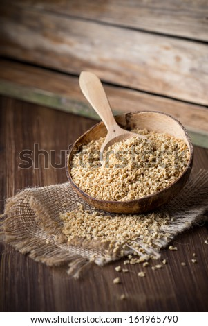 Soy wooden bowl on a wooden surface, eco product.