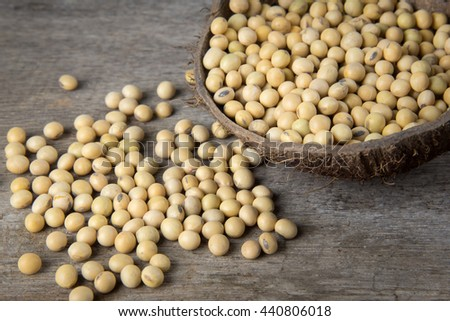 Soya beans in coconut shell on wooden background.