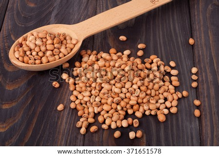 soya beans scattered on the wooden table. - stock photo