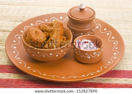 Soya Chaap Cooked in a Creamy Sauce with Missi Roti - stock photo