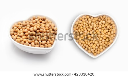 Soybean in a heart shaped bowl, isolated on white - stock photo