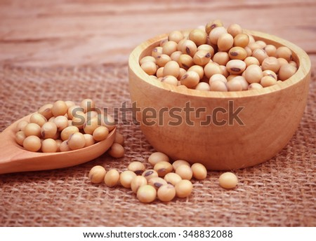 soybean in the wooden cup on the wood table