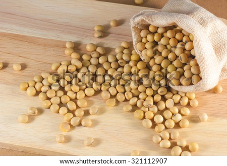 soybean or Yellow bean in sack on wood background