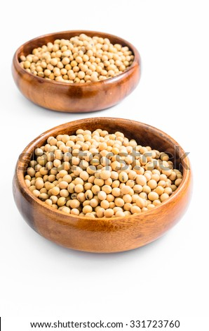 soybeans in wooden bowl isolated on white background