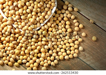 Soybeans on old wood background