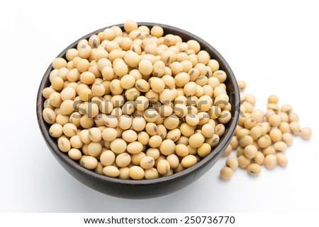 Soybeans on wooden bowl isolated on a white background. - stock photo