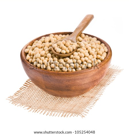 Soybeans on wooden spoon in a wooden bowl isolated on a white background. - stock photo