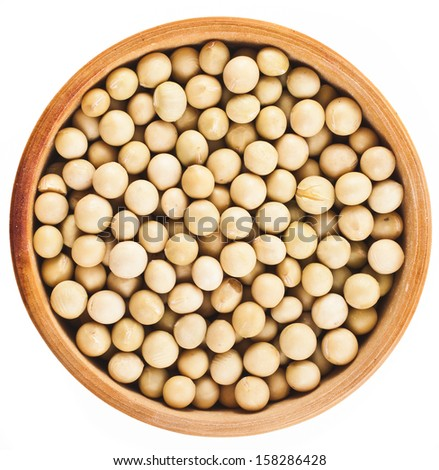 soybeans over wooden bowl dish  top view surface close up isolated on a white background  - stock photo
