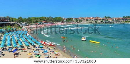 SOZOPOL, BULGARIA - SEPTEMBER 2, 2015: Panorama of the Central city beach. Sozopol was founded in the 7th century BC by Greek colonists. Today it is one of the major seaside resorts in the country. - stock photo