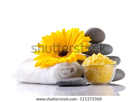 spa accessories and yellow flower on white background - stock photo
