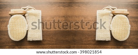 SPA accessories - brush, sponge isolated on wooden table background - stock photo