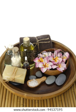 Spa accessories in wooden bowl on mat - stock photo