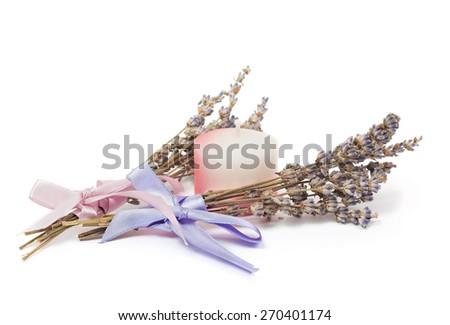 Spa Accessories, two bunches of lavender with ribbon and a candle isolated on white - stock photo