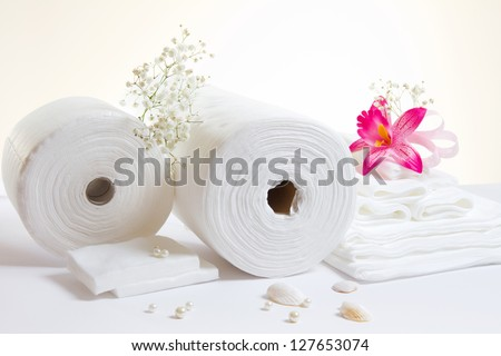 Spa accessories: white sheets and towels on white background - stock photo