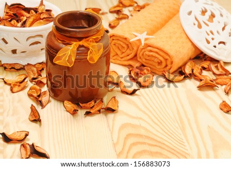 spa accessories with orange dried petals for relaxation