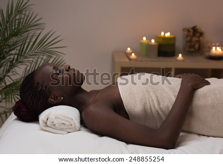 Spa African Woman in Beauty Salon - stock photo