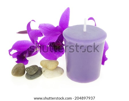 Spa and aroma therapy setting with orchid and candle isolated on white background