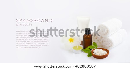Spa and organic products background / Essential oil, sea salt, towels, candles, jasmin leaves, Frangipani flower and body cream.
