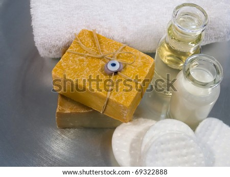 Spa and skincare products arranged on a silver tray, including handmade soaps, cleansers and essential oils - stock photo