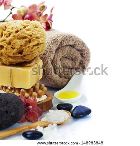 Spa and Wellness- bath brush, pumice stone, sponge, towel, orchid, sea salt and soap over white  - stock photo