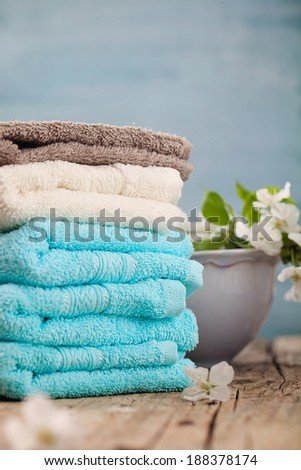 Spa and wellness setting with flowers and towels. Beige dayspa nature set with copyspace - stock photo