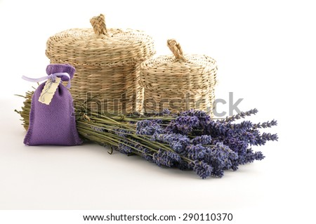 Spa and wellness setting with lavender flowers and baskets - stock photo