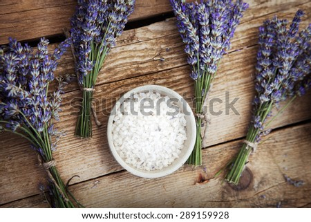 Spa and wellness setting with lavender flowers, floral water and bath salt. Dayspa nature set - stock photo