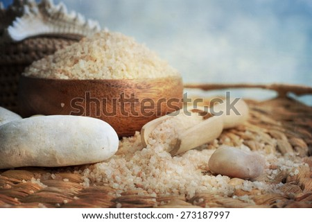 Spa and wellness setting with natural bath salt, candles