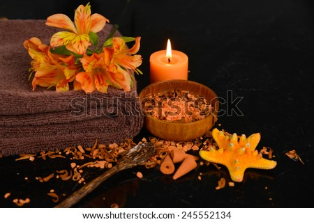 Spa and wellness setting with natural bath salt, candles and towel, starfish - stock photo