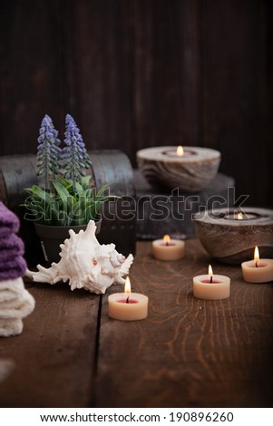 Spa and wellness setting with natural bath salt, candles, towels and flower. Wooden dayspa nature set - stock photo