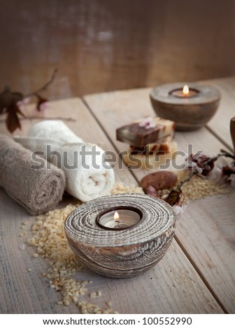 Spa and wellness setting with natural soap, candles and towel. Beige dayspa nature set - stock photo