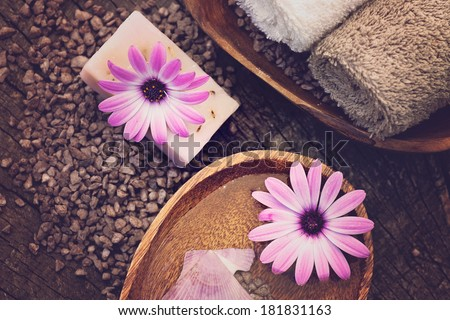 Spa and wellness setting with natural soap, candles and towel. Violet dayspa nature set dayspa nature set