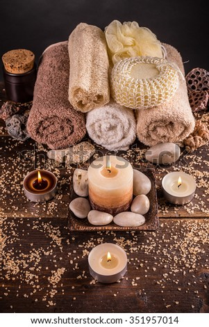 Spa and wellness setting with towels and candles - stock photo