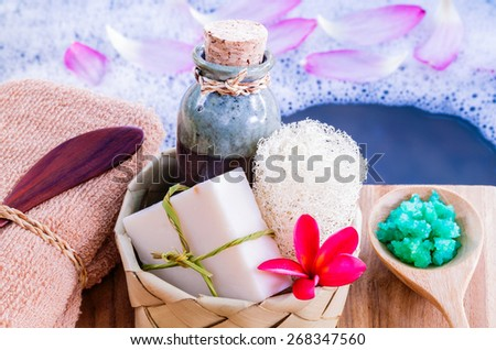 Spa and wellness treatment setup on wooden panel. - stock photo