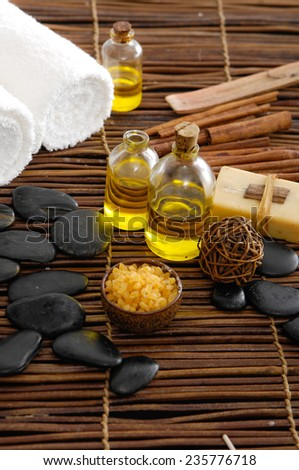 Spa aroma bowl of salt and towel and oil, stones ,soap on mat - stock photo