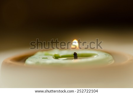 Spa aroma candle flame with water steam - stock photo
