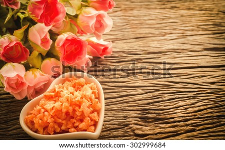 Spa & aromatherapy concept,rose flower with spa sea salt on wooden background in the vintage style. - stock photo