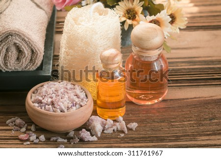 Spa & aromatherapy concept,sea salt,essential oil and potpourri on wooden background in the vintage style.