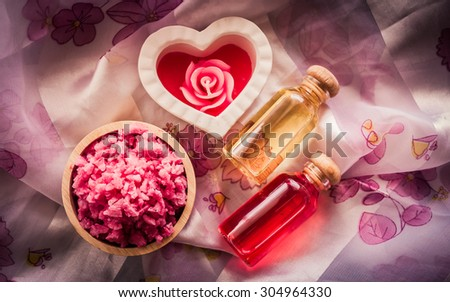 Spa & aromatherapy concept, spa sea salt with candle aroma in the vintage style.(soft focus with dark tones) - stock photo