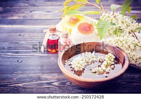 Spa aromatherapy set. Flowers, massage oil, sea salt  - stock photo
