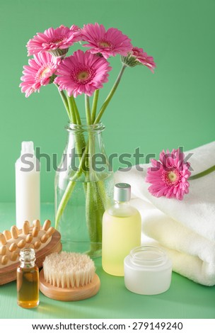 spa aromatherapy with gerbera flowers essential oil brush  - stock photo