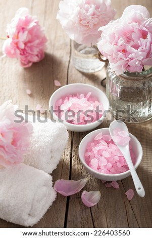 spa aromatherapy with peony flowers and pink herbal salt - stock photo