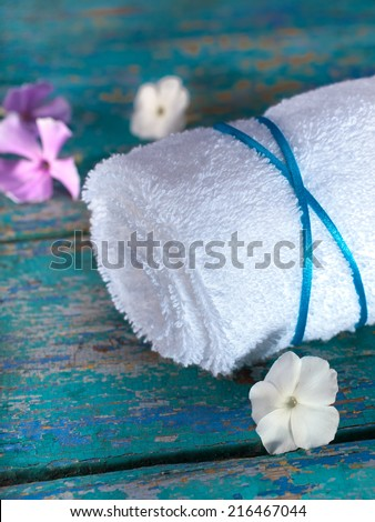 Spa background: a white towel on blue. - stock photo