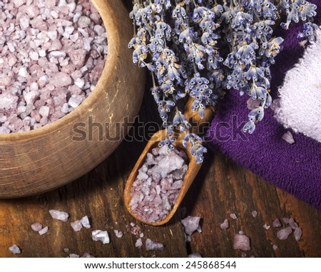 Spa background with bunch of lavender and purple sea salt. - stock photo