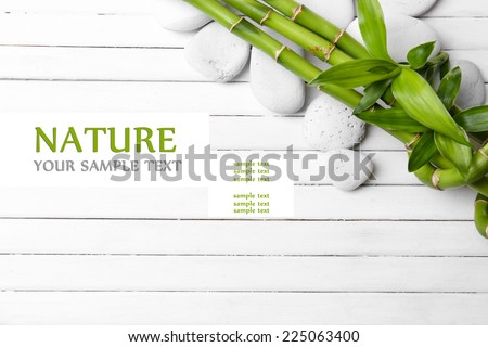 Spa bamboo on wooden background - stock photo