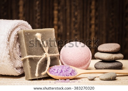 Spa bath cosmetic. Soap beauty treatment background. Aromatherapy with natural salt and stones. Hygiene and relaxation for body. White towel. Luxury therapy and care. Health product. - stock photo