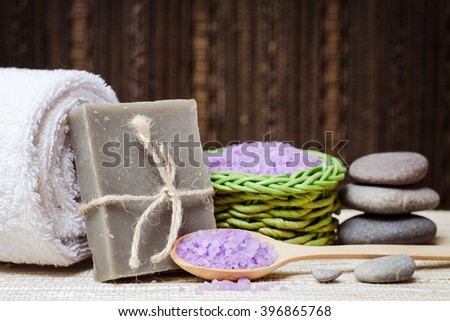 Spa bath cosmetic. Soap beauty treatment background. Aromatherapy with natural salt and stones. Hygiene and relaxation for body. White towel. Luxury therapy and care. Health product.