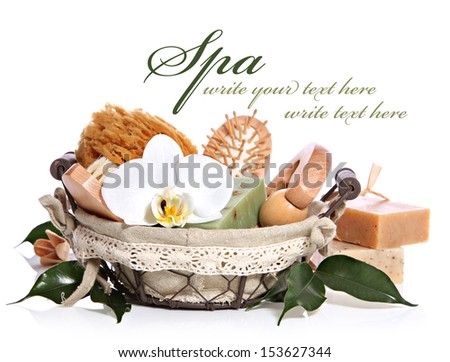 Spa bath kit or sauna toiletries set in basket with white orchid flower - stock photo